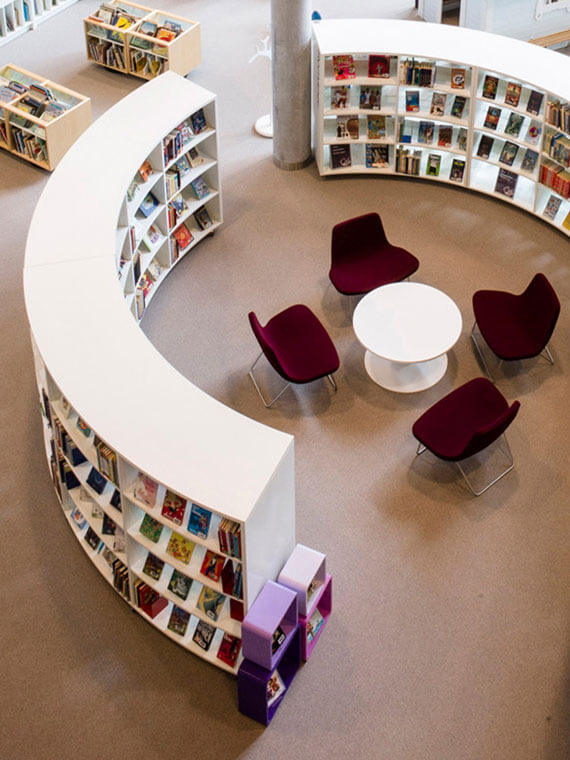 View looking down at a curved shelving system